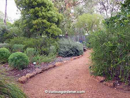 Earthen paths meander through the garden in a most delightful way